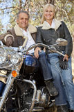 Close up of senior couple with motorcycle Stock Photography