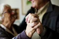 Close up of senior couple`s hands as they are dancing royalty free stock image