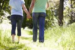 Close Up Of Senior Couple Walking In Summer Countryside Royalty Free Stock Photos
