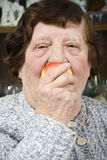 Close up senior eat an apple Stock Image