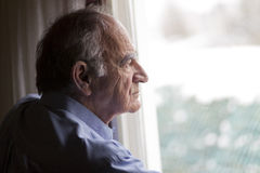Close up of a senior man. Contemplating royalty free stock photo