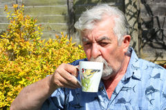 Close up of a Senior man drinking coffee. Royalty Free Stock Photo