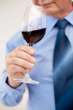 Close up of senior man drinking wine from glass. Profession, drinks, holidays and people concept - close up of senior man drinking red wine from glass Stock Photography