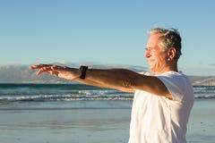 Close up of senior man exercising at beach Royalty Free Stock Photos
