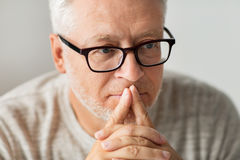 Close up of senior man in glasses thinking Stock Images