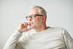 Close up of senior man in glasses thinking Royalty Free Stock Image