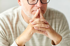 Close up of senior man in glasses thinking Royalty Free Stock Images