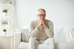 Close up of senior man in glasses thinking Stock Photos
