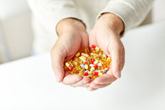 Close up of senior man hands holding pills Stock Images