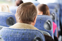 Close up of senior man sitting in travel bus Royalty Free Stock Photography