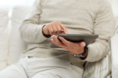 Close up of senior man with tablet pc at home Royalty Free Stock Photography