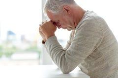 Close up of senior man thinking. Old age, problem and people concept - close up of senior man thinking Royalty Free Stock Images