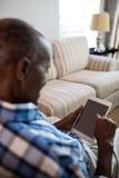 Close up of senior man using tablet Royalty Free Stock Photo