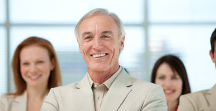 Close-up of a senior manager with his team Royalty Free Stock Photo