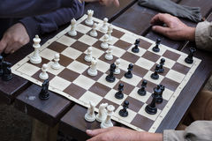 Close up of senior men playing chess. Royalty Free Stock Photo