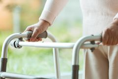Senior person using a walker stock photography