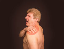 Close-up of senior shirtless man with shoulder pain over black background. Close-up of senior shirtless man with shoulder pain over white background stock photos