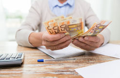 Close up of senior woman counting money at home Royalty Free Stock Photography