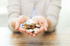 Close up of senior woman hands holding money. Savings, money, annuity insurance, retirement and people concept - close up of senior woman hands holding money jar royalty free stock photography