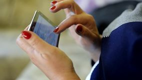 Close up of senior woman hands internet surfing on smart phone stock footage
