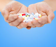 Close up of senior woman hands with pills Stock Image