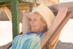 Close up of senior woman looking away while relaxing on chair Stock Images