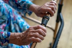 Close-up of senior woman moving with the help of walker. Old sick woman 90 years in the hospital royalty free stock photos