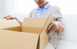 Close up of senior woman with parcel box at home Stock Photo