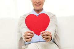 Close up of senior woman with red heart at home Royalty Free Stock Images