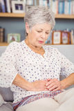 Close-up of senior woman suffering from stomach pain Stock Photos