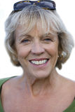 Close-up of senior woman with sunglasses on head, cut out Royalty Free Stock Photos