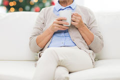 Close up of senior woman with tea cup at christmas Stock Photo
