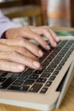 Close up of senior woman typing on laptop Royalty Free Stock Images