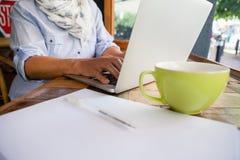 Close up of senior woman working on laptop Stock Image