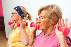 Close up of senior women with weights. Stock Photography
