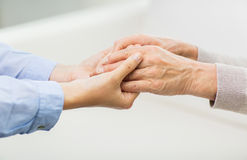 Close up of senior and young woman hands Stock Images