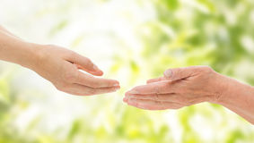 Close up of senior and young woman hands Royalty Free Stock Images