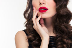 Close up of sensual beautiful curly woman with red lips Stock Photos
