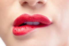Close up on sensual model biting red lips Stock Photography
