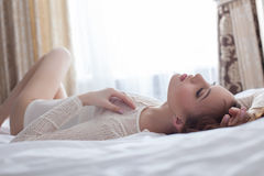Close-up of sensual woman lying on bed Stock Photography