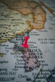 Close up of Seoul pin pointed on the world map with a pink pushpin stock photos