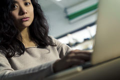 Close up of serious Asian girl looking at you Royalty Free Stock Image