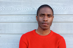 Close up serious black guy in red sweater. Close up portrait of serious black guy in red sweater stock photography