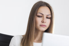 Close up of serious blond businesswoman in office Royalty Free Stock Photos