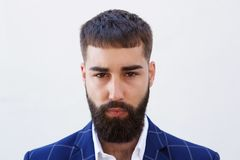 Close up serious businessman with beard staring. Close up portrait of serious businessman with beard staring Royalty Free Stock Photography