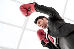 Close up.serious businessman in Boxing gloves. Concept of competitiveness stock photo