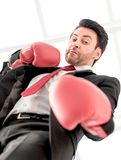 Close up.a serious businessman in red Boxing gloves. Photo with copy space stock photo