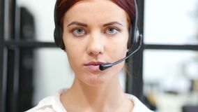 Close Up Of Serious Call Center Woman Face stock video footage