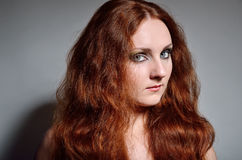 Close-up of serious ginger woman Royalty Free Stock Photo