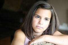 Close up of serious latina girl. Headshot of beautiful hispanic girl Royalty Free Stock Photo